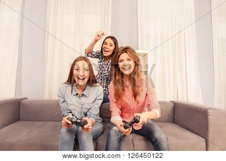 Attractive Cheerful Girls Having Fun And Playing Video Games