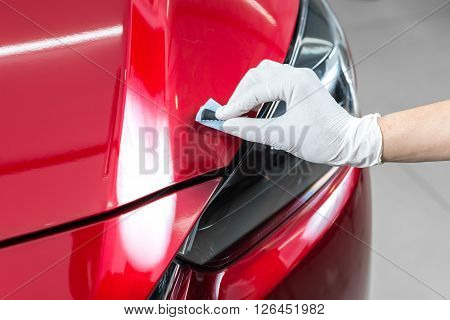 Car detailing series : Closeup of hand  coating car paint