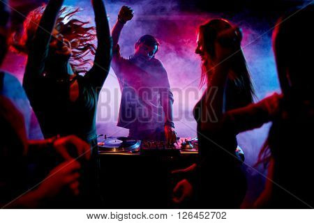 Ecstatic dj and dancers
