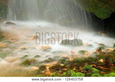 Shinning Drops. Cascade Of Small Mountain Stream, Mossy Boulders.