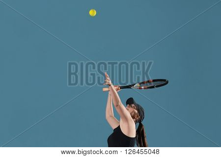 Young Female Ready To Serves Toss Ball