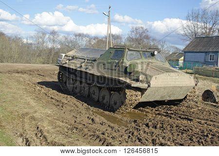large old vintage all terrain vehicle on tracks