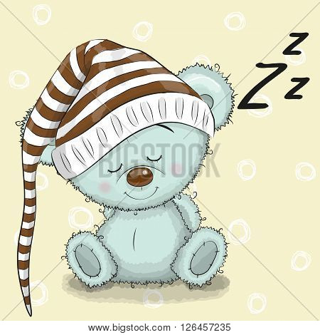 Sleeping cute Teddy Bear in a hood on a white background