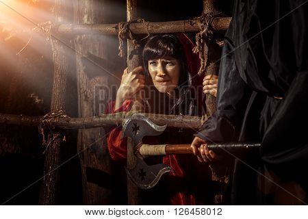 Beautiful Witch In Red Dress In The Dungeon Is Looking On The Sunray.