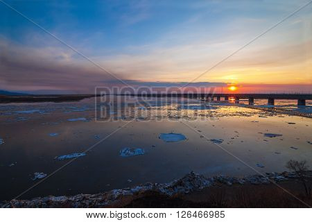 Floating of ice in spring on Amur river in Khabarovsk Russia