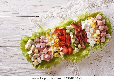 American Cobb Salad On A Plate On The Table. Horizontal Top View