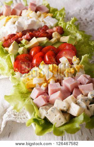 Sliced Cobb Salad Close-up On A Plate. Vertical