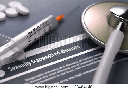 Sexually transmitted diseases - Printed Diagnosis on Grey Background with Blurred Text and Composition of Pills, Syringe and Stethoscope. Medical Concept. Selective Focus. 3D Render.