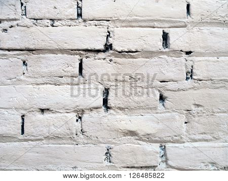 Detail of an old white brick wall