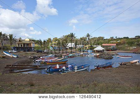 HANGA ROA, EASTER ISLAND, CHILE - APRIL 6, 2016: Fishing boats in a small harbour in HANGA ROA, capital of Easter Island.