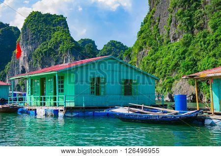 Floating fishing village near mountain islands in Halong Bay, Vietnam, Southeast Asia