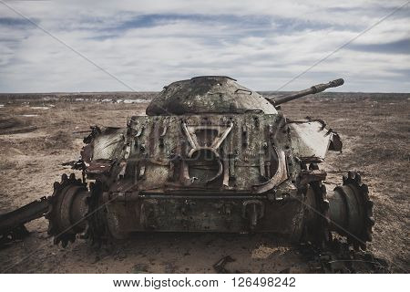Old destroyed tank left on the battlefield
