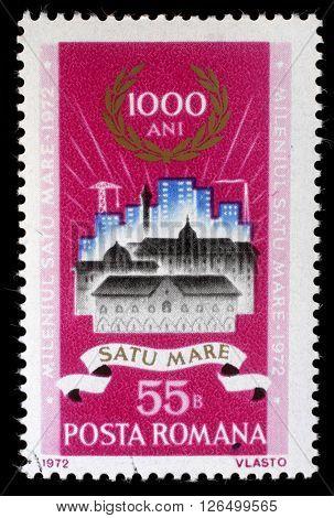 ZAGREB, CROATIA - JULY 08: a stamp printed in Romania shows Old and new buildings in Satu-Mare, Satu-Mare milenium issue, circa 1972, on July 8, 2012, Zagreb, Croatia
