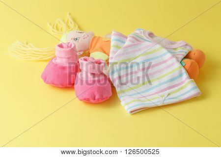 Baby Clothing And Doll
