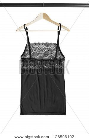 Black lacy lingerie top on clothes rack isolated over white