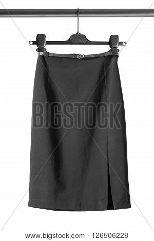 Black pencil slit skirt on clothes rack isolated over white