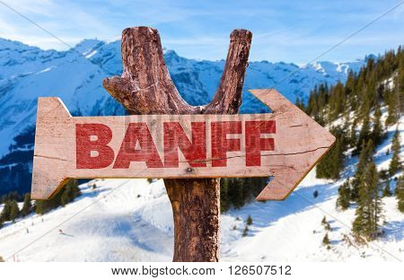 Banff wooden sign with winter background
