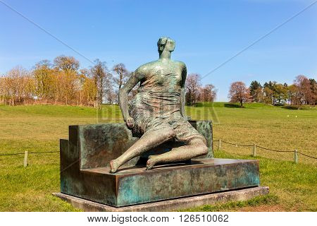 WAKEFIELD, YORKSHIRE, UK - APRIL 19: Draped Seated Woman, c1957-58 bronze sculpture by Henry Moore in Yorkshire Sculpture Park on April 19. 2016.