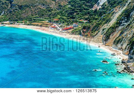 Petanoi Beach, Cephalonia. View of Petani bay and beautiful beach, Kefalonia island, Greece. People relaxing at the beach.