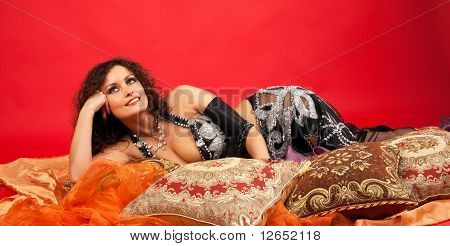 Beauty woman lay on pillow and smile