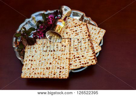 Top View  Wine And Matzoh Jewish Passover Bread Over Wooden Background.
