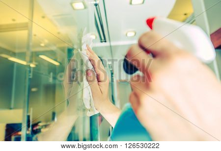 Office Windows Cleaning. Male Worker Cleaning Glass Walls in the Office Area. Cleaning Service.
