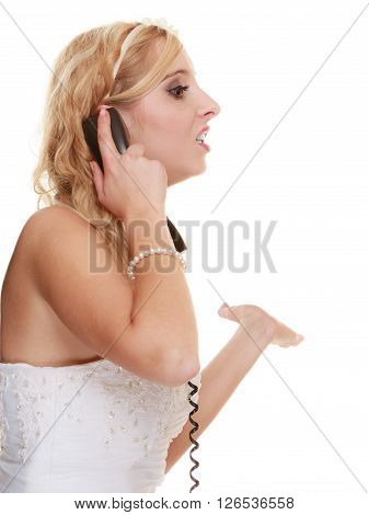 Wedding relationship difficulties. Angry woman talking on the phone. Fury bride screaming isolated on white.