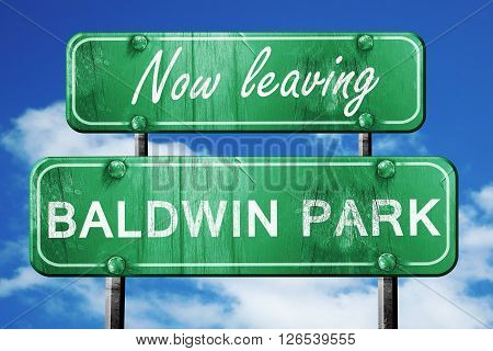 Now leaving baldwin park road sign with blue sky