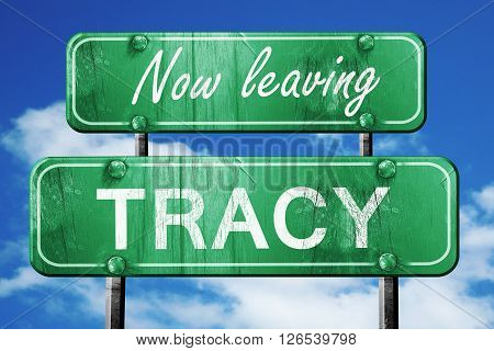 Now leaving tracy road sign with blue sky