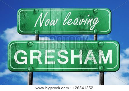 Now leaving gresham road sign with blue sky
