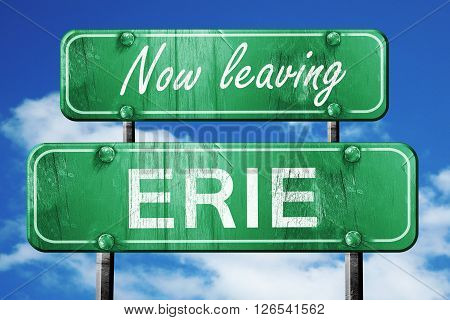 Now leaving erie road sign with blue sky