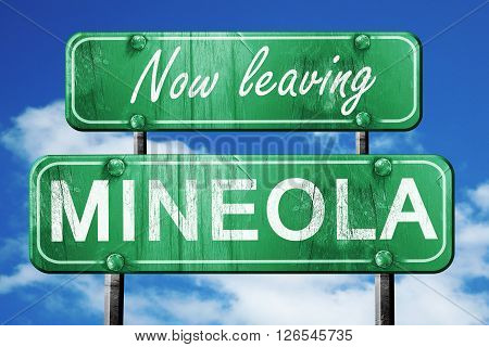 Now leaving mineola road sign with blue sky