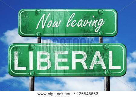 Now leaving liberal road sign with blue sky