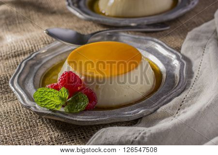 Two Dessert Plates with Caramel Flan and Raspberries