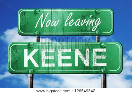Now leaving keene road sign with blue sky