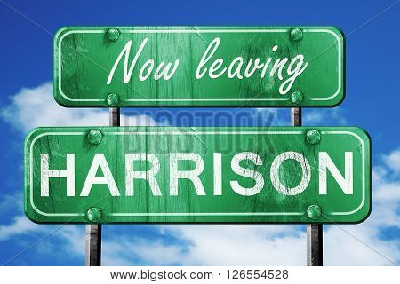 Now leaving harrison road sign with blue sky