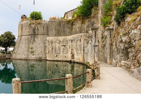 KOTOR, MONTENEGRO - AUGUST 30, 2009: Gurdic gate with portcullis and moat at the south entrance of Kotor old town