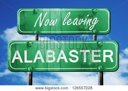 Now leaving alabaster road sign with blue sky