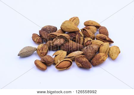 The almonds isolated on the white background ** Note: Shallow depth of field