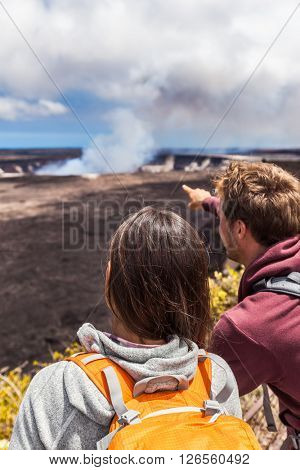 Hawaii scene. Hiking people looking at Hawaiian volcano: Halemaumau crater within the Kilauea Volcano caldera in Hawaii volcanoes national park on Big Island.