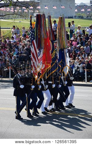 WASHINGTON, DC - APR 16: Marching at the 2016 National Cherry Blossom Parade in Washington DC, as seen on April 16, 2016. Thousands of visitors gathered to attend this annual event.
