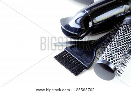 Tools for hairdresser (hair dryers, scissors, combs) poster