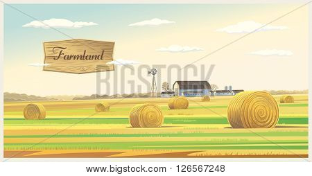 Autumn landscape with hay, and farm on the back plan.