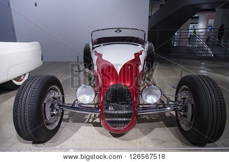 Los Angeles, CA, USA -- April 16, 2016: Red and white 1927 Ford Roadster reproduction  by Roy Brizio's Street Rods at the Petersen Automotive Museum in Los Angeles, California, United States.