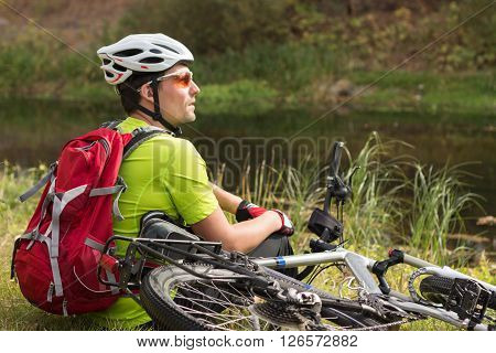 Male cyclist traveling with bike and backpack.