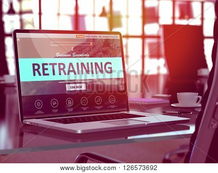 Modern Workplace with Laptop showing Landing Page with Retraining Concept. Toned Image with Selective Focus. 3D Render.