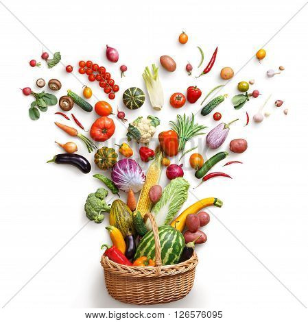 Healthy food in basket. Studio photography of different fruits and vegetables isoleted on white backdrop top view. High resolution product.
