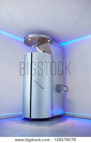 Cryotherapy capsule in cosmetology clinic. Cryo sauna for whole body cryotherapy treatment.