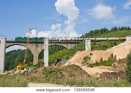 New Railway Bridge On A Background Blue Sky