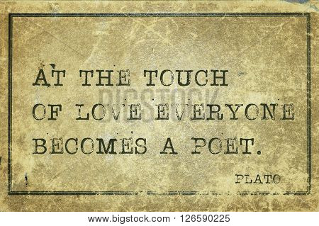 At the touch of love everyone becomes a poet - ancient Greek philosopher Plato quote printed on grunge vintage cardboard